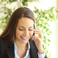 A woman talking on the phone.